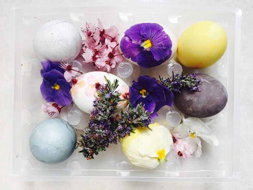 Easter eggs decorated with natural dyes and pressed flowers